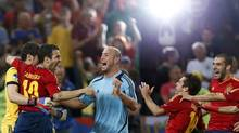 Spain's players celebrate after defeating Portugal in their Euro 2012 semi-final soccer match at the Donbass Arena in Donetsk, June 27, 2012. (CHARLES PLATIAU/REUTERS)