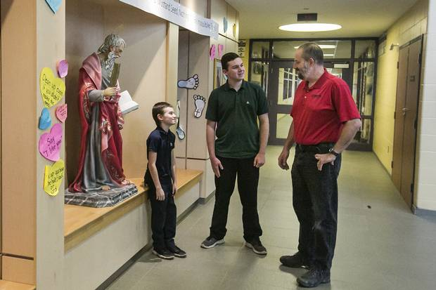 Andrew Bienhaus (right), who is not Catholic, has two sons attending Catholic schools. Connor (left), 9, attends St. Matthew Catholic Elementary in Binbrook while Sean (centre), 15, attends Bishop Ryan in Hamilton.