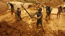 Artisanal miners dig for gold in an open-pit concession near Dunkwa, western Ghana in this Feb. 15, 2011, file photo. (STR/Reuters)