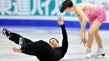 Scott Moir falls in front of his partner Tessa Virtue of Canada as they perform their short program in the ice dance competition at the ISU Grand Prix of Figure Skating Final Friday, December 9, 2011 in Quebec City. THE CANADIAN PRESS/Paul Chiasson (Paul Chiasson/CP)