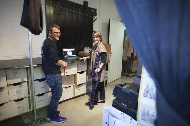 Kim Gaynor, right, with Michael Mann, left, digital communications manger, in the wardrobe department of the Vancouver Opera facility.