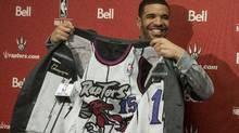 Hip Hop Star and MLSE ambassador Drake shows off the lining of his suit during a press conference before the Toronto Raptors' NBA game against Brooklyn Nets in Toronto on Saturday Jan. 11. (Chris Young/Canadian Press)
