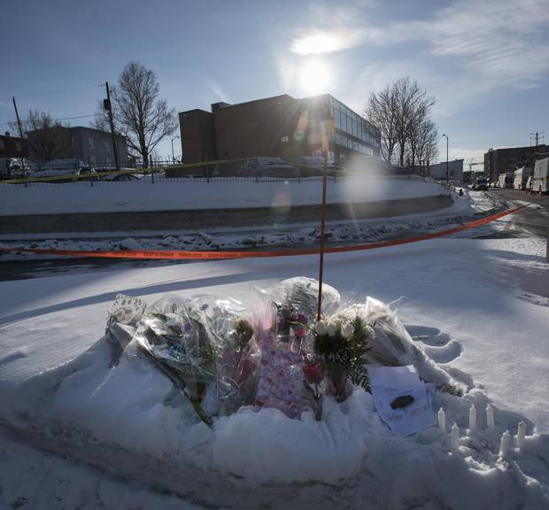 Flowers and notes are laid at a makeshft memorial near the Centre culturel islamique de Québec on Jan. 30, 2017.