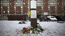 A makeshift memorial in front of 605 Whiteside Place in Toronto's Regent Park Jan 24, 2013, a few days after 15-year-old youth Tyson Bailey was shot and killed here. (Moe Doiron/The Globe and Mail)