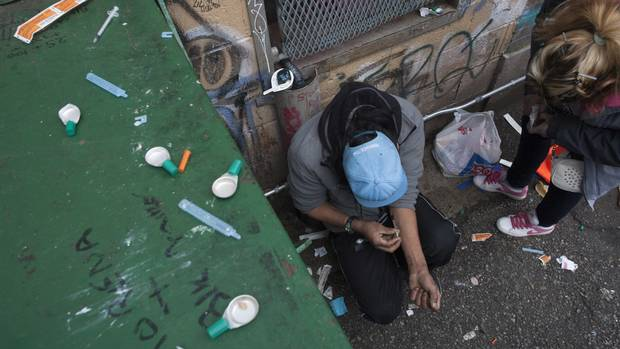 A drug user injects in Vancouver's Downtown Eastside.
