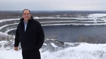 Northland Power business development director John Wright overlooks the Marmora mine site, where the company plans to build an artificial waterfall that would pump water into a reservoir when electricity prices are low, and let it fall to a powerhouse below to generate electricity when prices are high. (Shawn McCarthy/The Globe and Mail)
