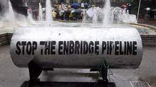 A giant piece of pipeline is placed in front of the Vancouver Art Gallery in downtown Vancouver, Tuesday, August 31, 2010. The pipeline was brought there by opponents of the Northern Gateway Pipeline Project. (Jonathan Hayward/THE CANADIAN PRESS)
