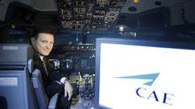 Marc Parent, president and CEO of CAE Inc., poses inside a flight simulator. (Christinne Muschi For The Globe and Mail)