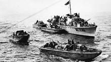Landing craft carrying the Queen's Own Cameron Highlanders to Dieppe draw away from a Royal Navy motor torpedo boat to start their approach to the beaches during the raid on Dieppe, Aug. 19, 1942. (DND)