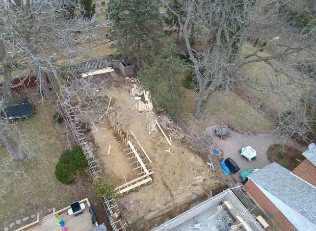 A pool is being constructed in the backyard.
