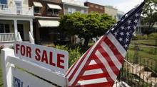 A U.S. flag decorates a for-sale sign at a home in the Capitol Hill neighbourhood of Washington. (JONATHAN ERNST/REUTERS)