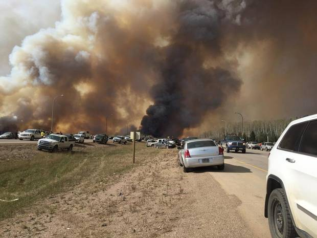 Abandoned vehicles litter Highway 63, south of Fort McMurray as residents fled the wildfire engulfing the city on Tuesday. Fuel shortages are being reported in the evacuation area.