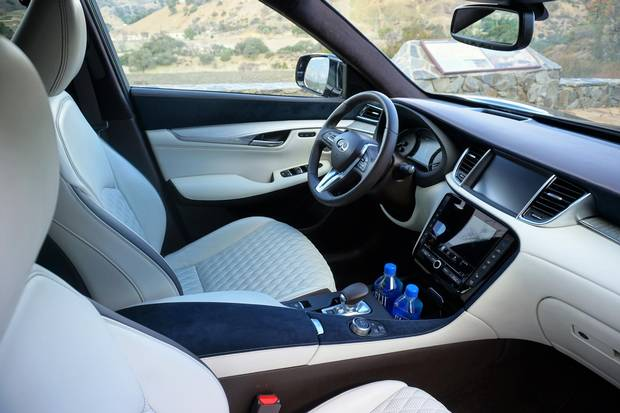The interior includes 'curated' materials, including Ultrasuede accents and aluminum or maple trim.