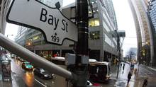 Toronto's Bay Street, home to Canada's financial district, is pictured in January, 2013. Sluggish corporate profits might force the Bank of Canada to reconsider its positive outlook for the rest of the year. (MARK BLINCH/REUTERS)