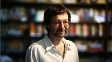 "Canadian fantasy fiction author Guy Gavriel Kay in his Toronto home in 2010: His new book is ""River of Stars."" (Fernando Morales/The Globe and Mail)"