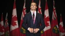 Ontario Premier McGuinty speaks to the media after making an announcement to resign from the leadership of the Ontario provincial Liberal party at Queen's Park in Toronto on Oct. 15, 2012. (MARK BLINCH/REUTERS)