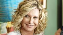 Olivia Newton-John, hockey mom (Ken Woroner)