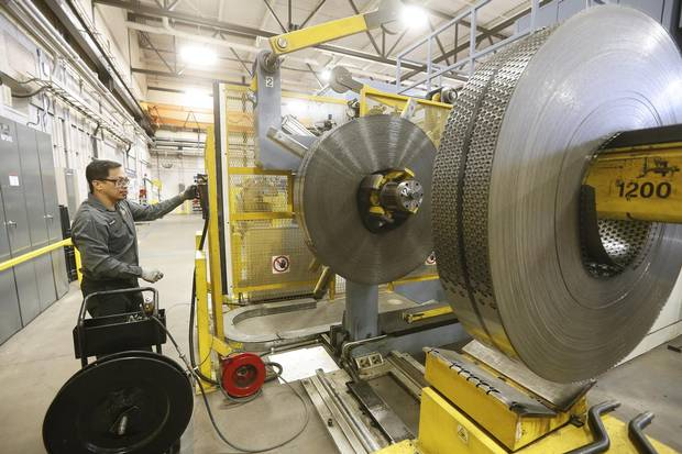 Rolls of steel from Ghana sit on the factory floor and it is expected to make about 3-400000 nickels from each roll at the Royal Canadian Mint in Winnipeg Tuesday, April 4, 2017.