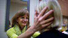 Physiotherapist Susan Rankin treats a patient at her North Vancouver, B.C. practice. (Darryl Dyck For The Globe and Mail)