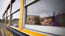 Native children leave the Chief Matthews School by bus in Old Masset, B.C., in October 2012. (John Lehmann/The Globe and Mail)