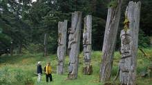 Ancient Haida poles on Anthony Island in Gwaii Haanas National Park Reserve. Under a new program that is being tried for the first time in British Columbia, the law-enforcement arms of the Ministry of Forests and the Ministry of Environment will be run jointly by the province and the Haida Nation. (Tourism British Columbia)