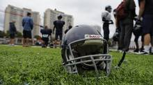 A football practice in 2012 at Toronto's St. Michael's College School, which performs baseline concussion tests on all athletes. New research presented at 2013's Heads Up Conference has drawn a link between sports concussions and substance abuse and suicidal thoughts. (Fred Lum/The Globe and Mail)