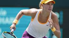 Eugenie Bouchard, of Canada, runs to the ball while playing against Jelena Jankovic, of Serbia, during the Family Circle Cup tennis tournament in Charleston, S.C., April 4, 2014. (MIC SMITH/THE CANADIAN PRESS)