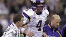 This Jan. 24, 2010, file photo shows Minnesota Vikings quarterback Brett Favre being helped off the field after being hit during the third quarter of the NFC Championship NFL football game against the New Orleans Saints, in New Orleans. The NFL says that New Orleans Saints players maintained a bounty program over the last three seasons that targeted opponents with the intent to injure them. The league disclosed the findings of an investigation Friday, saying between 22 and 27 defensive players and at least one assistant coach were involved. The NFL began its investigation in early 2010 after receiving allegations that quarterbacks Kurt Warner of Arizona and Brett Favre of Minnesota had been targeted. (AP Photo/Morry Gash, File) (Morry Gash/AP)