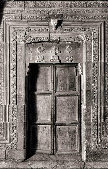 M?r Behnam (doorway) - Martyrion of M?r Behnam, c. 13th century. The Martyrion of M?r Behnam contains a trilingual inscription: Syriac, Arabic, and Uyghur (Old Turkic). Uyghur was used by the Mongols. This is the only known example of a Uyghur inscription in Iraq. It relates to a donation given to M?r Behnam by a Mongol Khan c. 1300 A.D. The monastery had been earlier ransacked by the Mongols; the donation was restitution. The b/w image was taken in the 1930's; the original was from a glass plate negative.