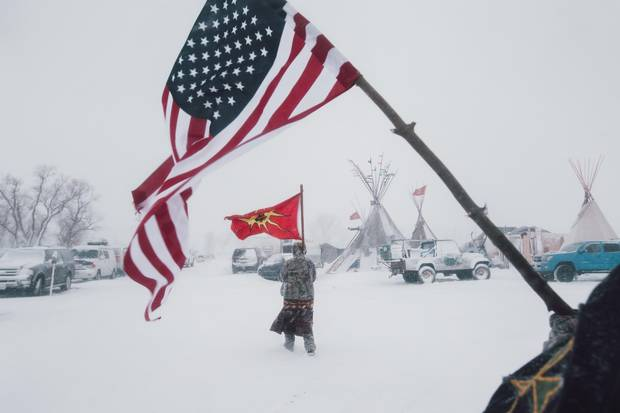Veterans had carried an American and a Mohawk Warrior Society flag through winter storms.