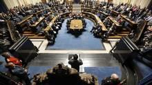 Manitoba's Lt.-Gov. Philip Lee reads the Manitoba Throne Speech at the Legislature in Winnipeg, Tuesday, November 12, 2013. (JOHN WOODS/THE CANADIAN PRESS)