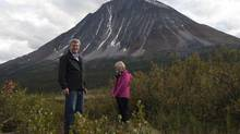 Canadian Prime Minister Stephen Harper and his wife Laureen take in the scenery as they stand on the ground where a new national park will be located in Moose Pond, North West Territories, August 21, 2012. (POOL/REUTERS)