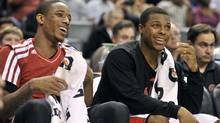 Toronto Raptors guard Kyle Lowry laughs on the bench during the second half of an NBA basketball game against the Minnesota Timberwolves in Toronto November 4, 2012. (MIKE CASSESE/REUTERS)