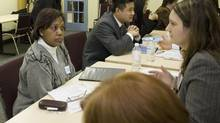 A speed mentoring event where senior bank officials from CIBC met with foreign-born professionals seeking employment and advice. (Ashley Hutcheson)