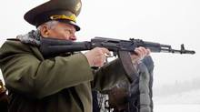 Russian designer Mikhail Kalashnikov, the creator of the world's most famous assault rifle, the AK-47, aims a current version of his weapon design at a shooting range in the Russian city of Izhevsk, about 1,000 kms east of Moscow, Saturday, Nov. 23, 2002. (STR/AP)