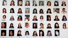 Detail of a posterboard of 48 missing women connected with the Robert Pickton serial killer case.. (Globe files/Globe files)