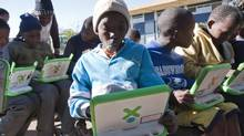 Children work on laptops at a youth centre in Kliptown, an area of Soweto, South Africa. (Erin Conway-Smith/Erin Conway-Smith for The Globe and Mail)