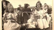 Jean Miller, then eight years old, celebrated the Queen's coronation in 1952 at a street party in Woodingdean, England. 'My sister and I wore our coronation dresses, especially sent to us for the occasion by our grandmother in South Africa,' Miller tells The Globe. (Courtesy of Jean Miller)