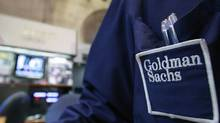 A trader works at the Goldman Sachs stall on the floor of the New York Stock Exchange, April 16, 2012. (BRENDAN MCDERMID/REUTERS)