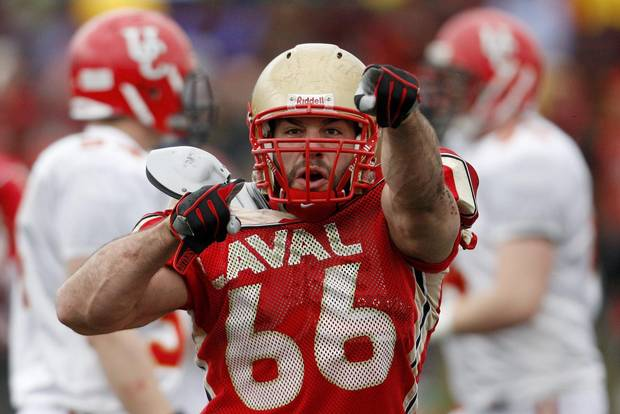 Laval University Rouge et Or Etienne Legare celebrates his sack against Univeristy of Calgary Dinos' quarterback Deke Junior during the second quarter of the Uteck Bowl college football game at Laval University in Quebec City.