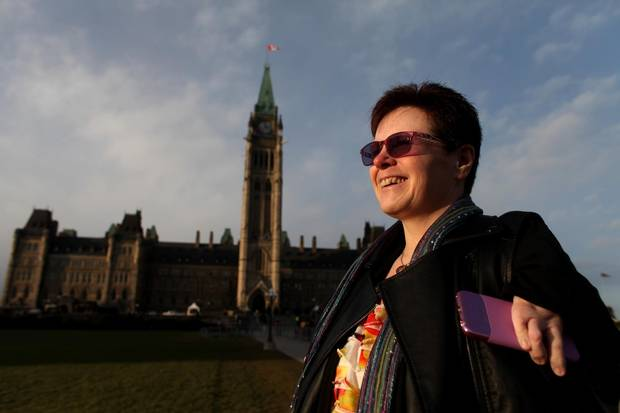 Thalidomide survivor Susan Wagner-White walk on the front steps of Parliament Hill on Dec. 1, 2014.
