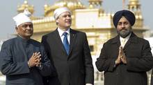 Prime Minister Stephen Harper examines the walls surrounding the Golden Temple as he visits the holy site in Amritsar, India, on Wednesday, November 18, 2009. (Adrian Wyld)