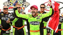 James Hinchcliffe, center, celebrates after winning the IndyCar series race in Newton, Iowa, Sunday, June 23, 2013. (Justin Hayworth/AP Photo)