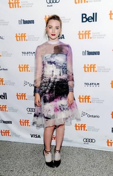 If God did snuff and then sneezed onto a silk handkerchief, the result would be Saoirse Ronan's dress at the Toronto International Film Festival in Toronto on Tuesday. (Evan Agostini/AP)