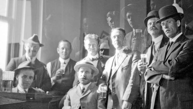 A group of men drinking beer in Vancouver, B.C., circa 1912.