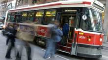 A TTC streetcar takes on passengers in Toronto on Nov. 17, 2009.