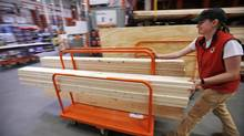 A shopper checks out with her lumber at a Home Depot in Boston. (GENE J. PUSKAR/AP)