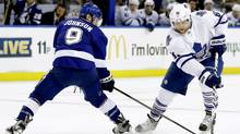 Phil Kessel of the Maple Leafs stickhandles around Tampa Bay's Tyler Johnson in Tampa on Thursday night. (Chris O'Meara/AP)