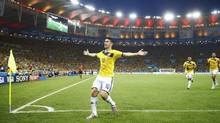 Colombia's James Rodriguez celebrates his goal against Uruguay during their 2014 World Cup round of 16 game at the Maracana stadium in Rio de Janeiro June 28, 2014. (KAI PFAFFENBACH/REUTERS)