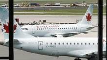 Air Canada planes sit on the tarmac at Pearson International Airport in Toronto in this file photo. (MIKE CASSESE/REUTERS)